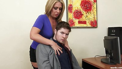 Sexy female boss Stevie Lix checks the characteristics of a new young wage-earner