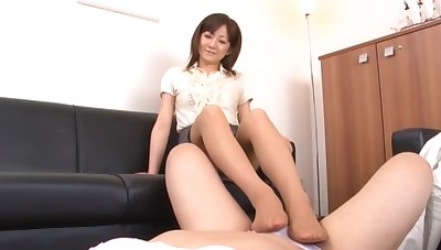 Asian unspecific gives a footjob and drops on her knees to blow