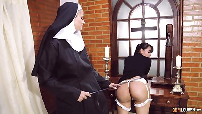 Unconventional nun puts her strapon close to great use when disciplining a doll